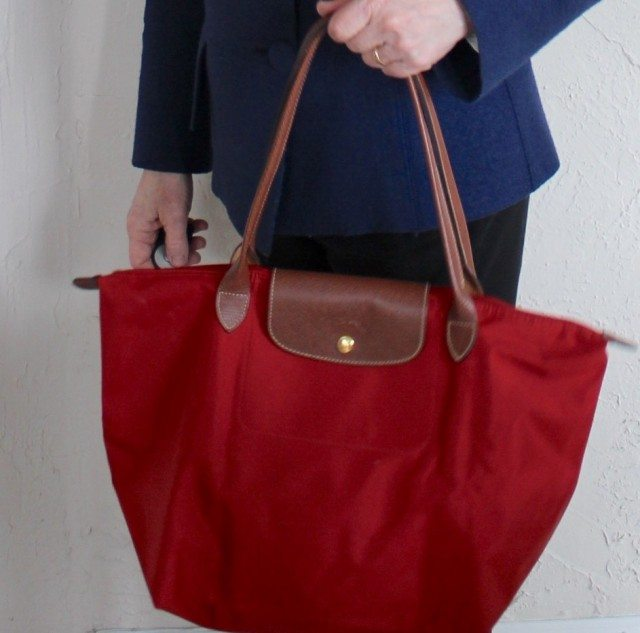 A light weight collapsible tote bag that goes over my sholder keeps my hands free.
