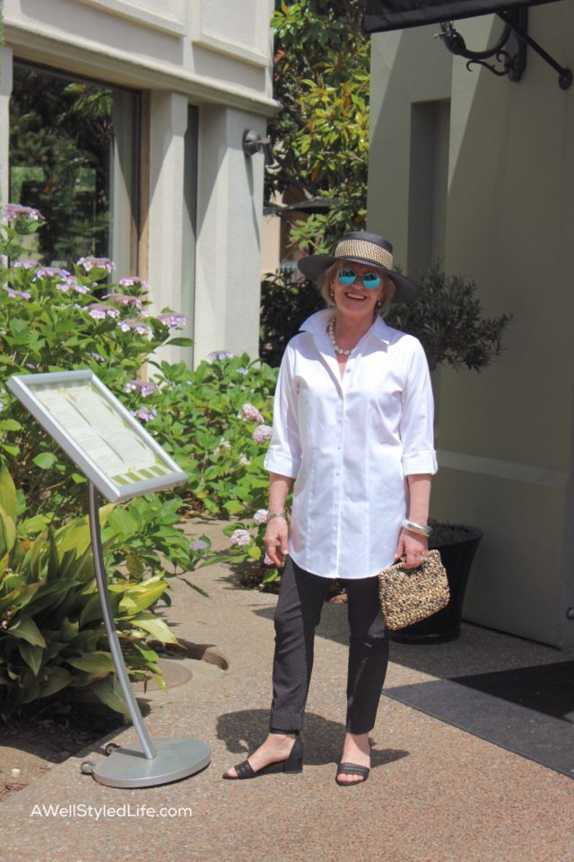 A fabulous white shirt, slim pants, pearls and a great hat make for perfect sightseeing attire
