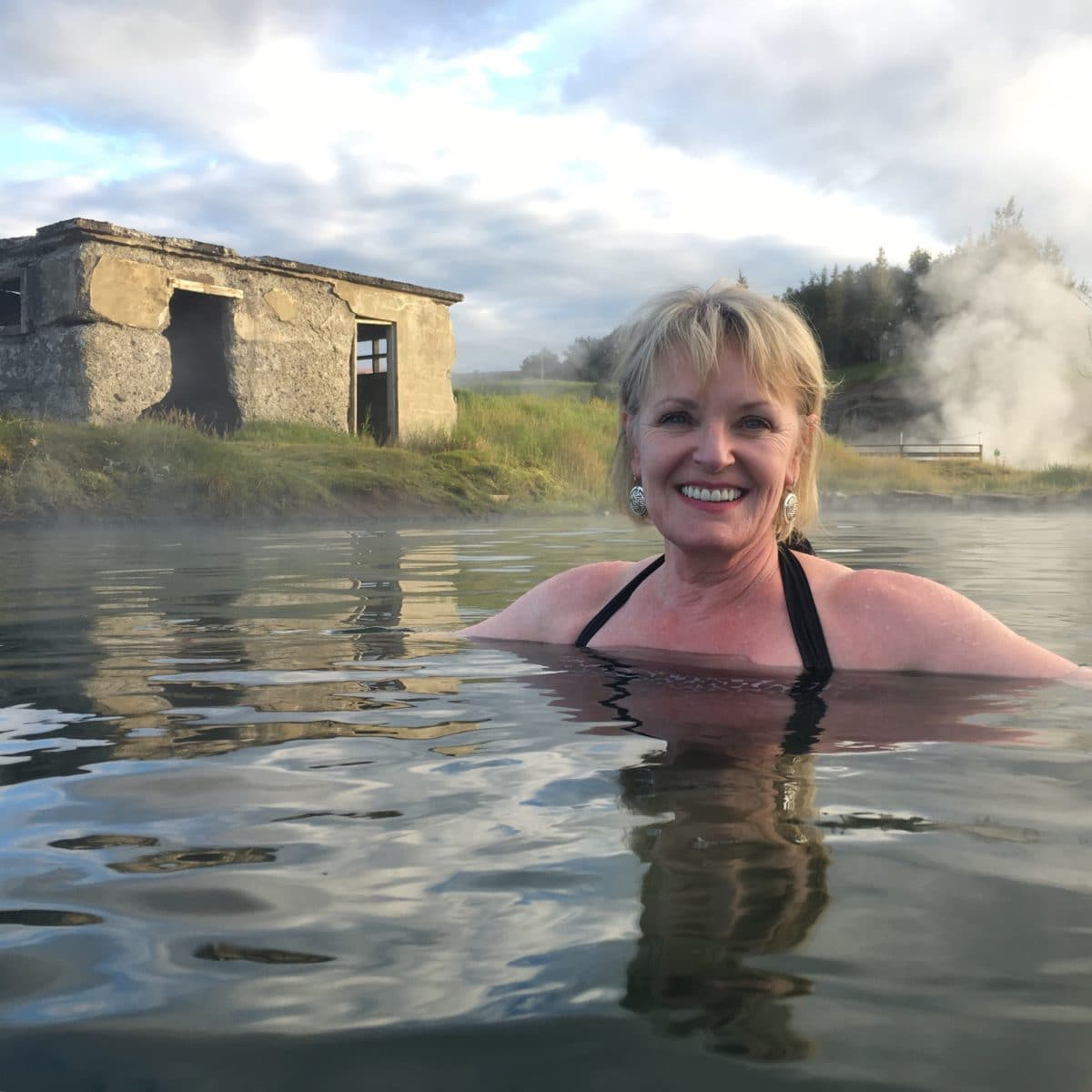 Jennifer Connolly of A Well Styled Life soaking in Secret Lagoon Iceland