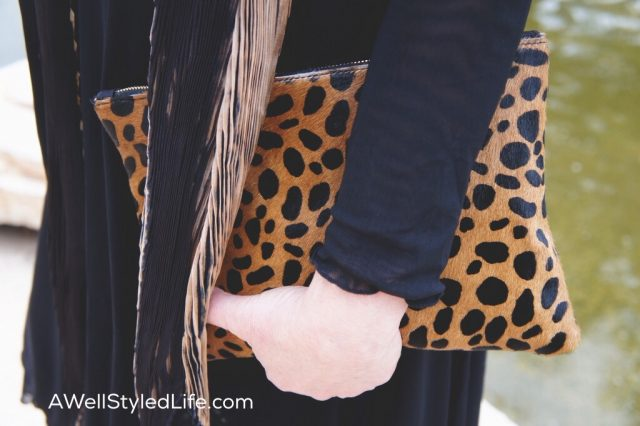 Claire V leopard clutch