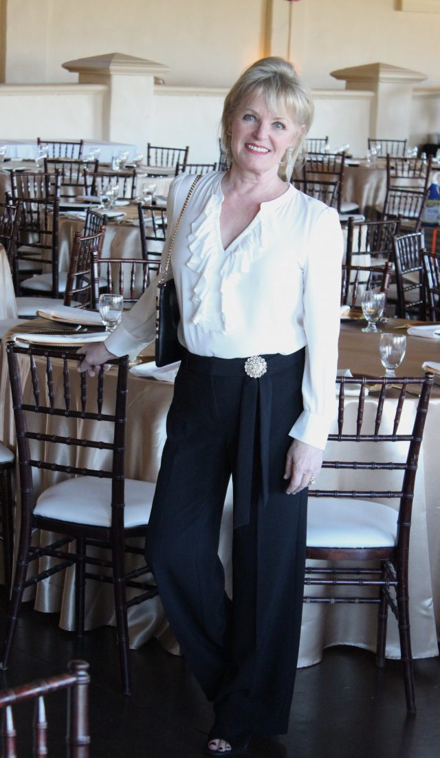 Black and white separates from Chico's with vinatge pin and suede booties