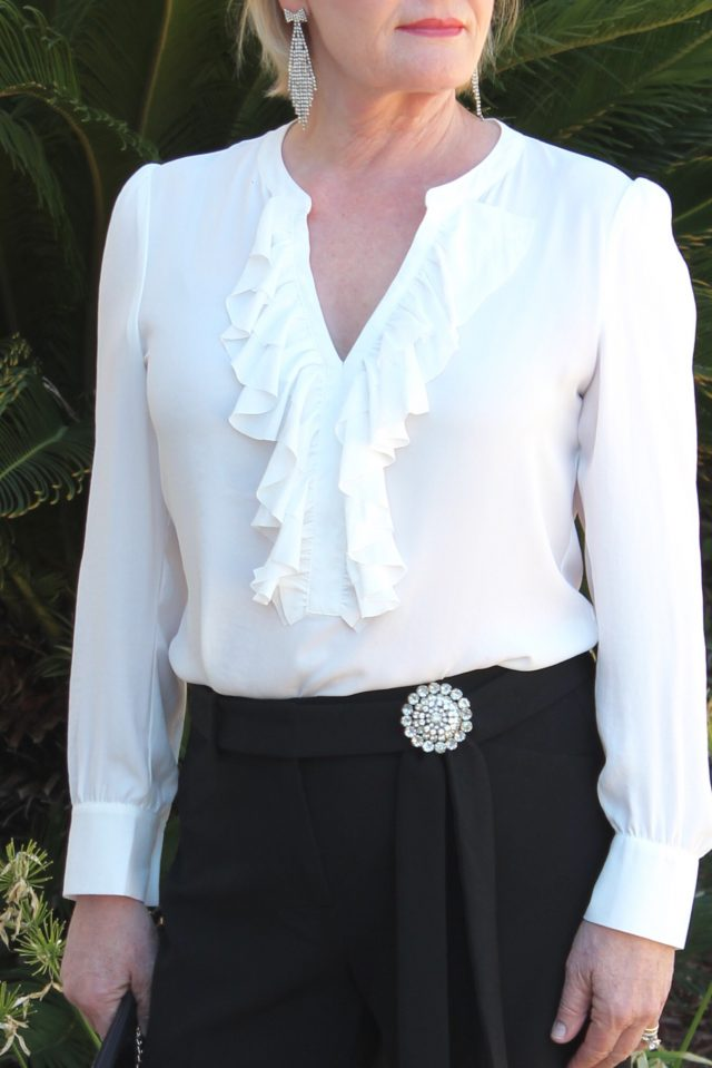 White ruffled blouse wiht nclassic black trousers from Chico's