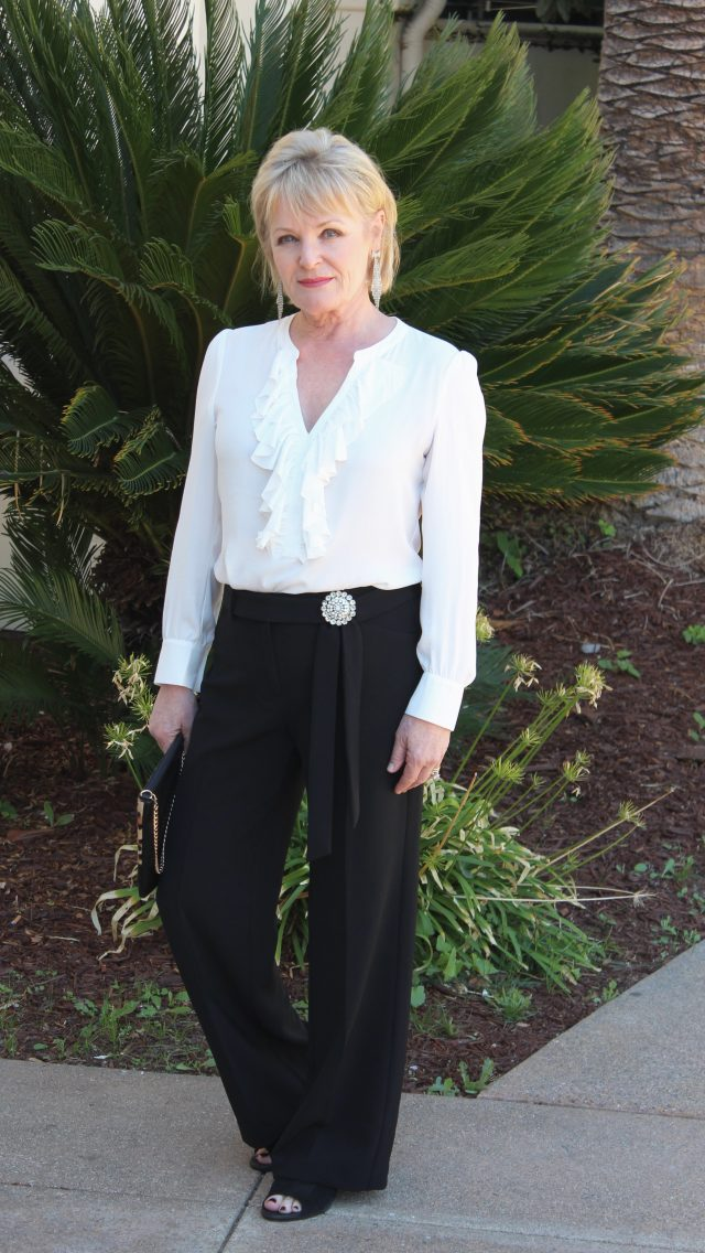 Chicos blacj and white separates with vintage pin at waistline