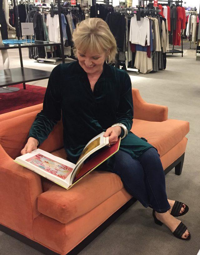 perusing a scarf book while shopping