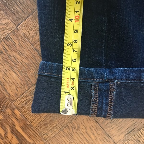 using tape measure to shorten jeans