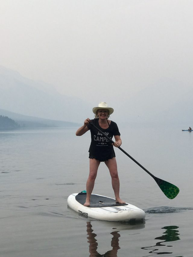 Jennifer Connolly of A well Styled life paddle boarding in Montana
