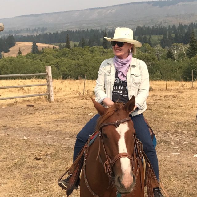Jennifer Connolly of A Well Styled Life riding a horse in Montana