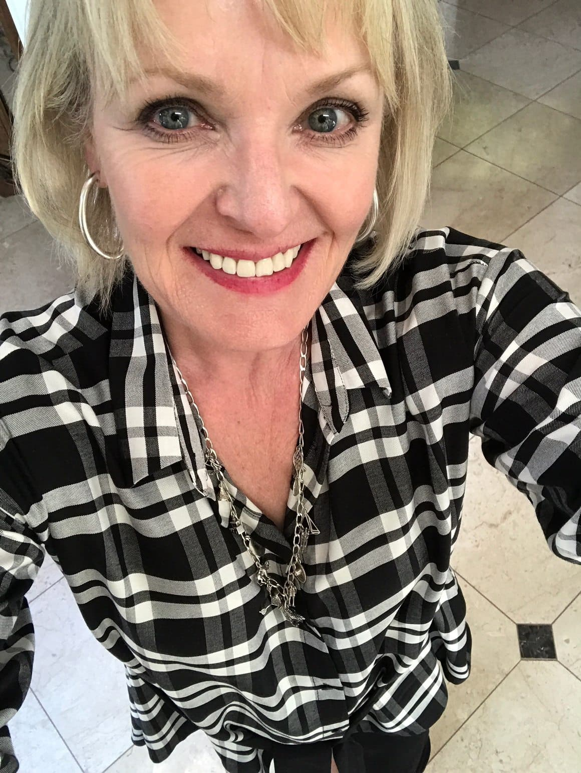 Jennifer Connolly of A Well Styled Life wearing charm necklace