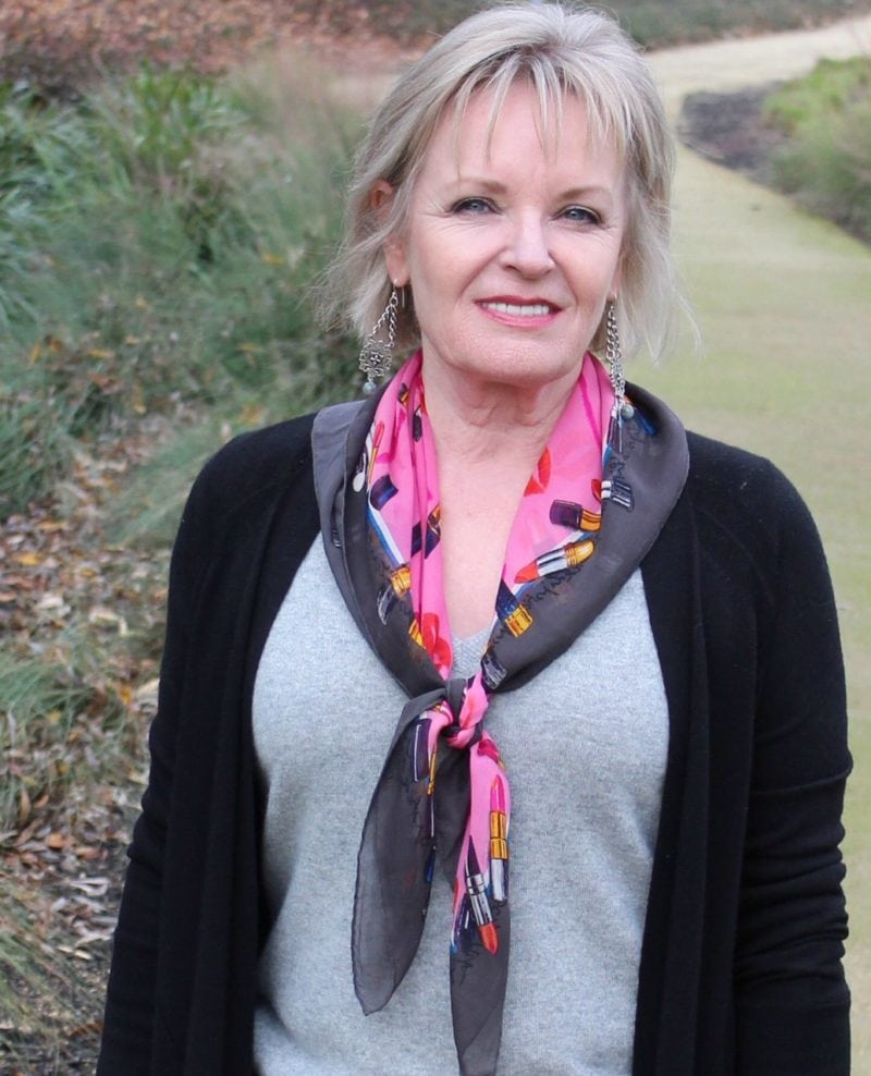 Jennifer Connolly of A Well Styled Life wearing pink scarf to brighten gray outfit