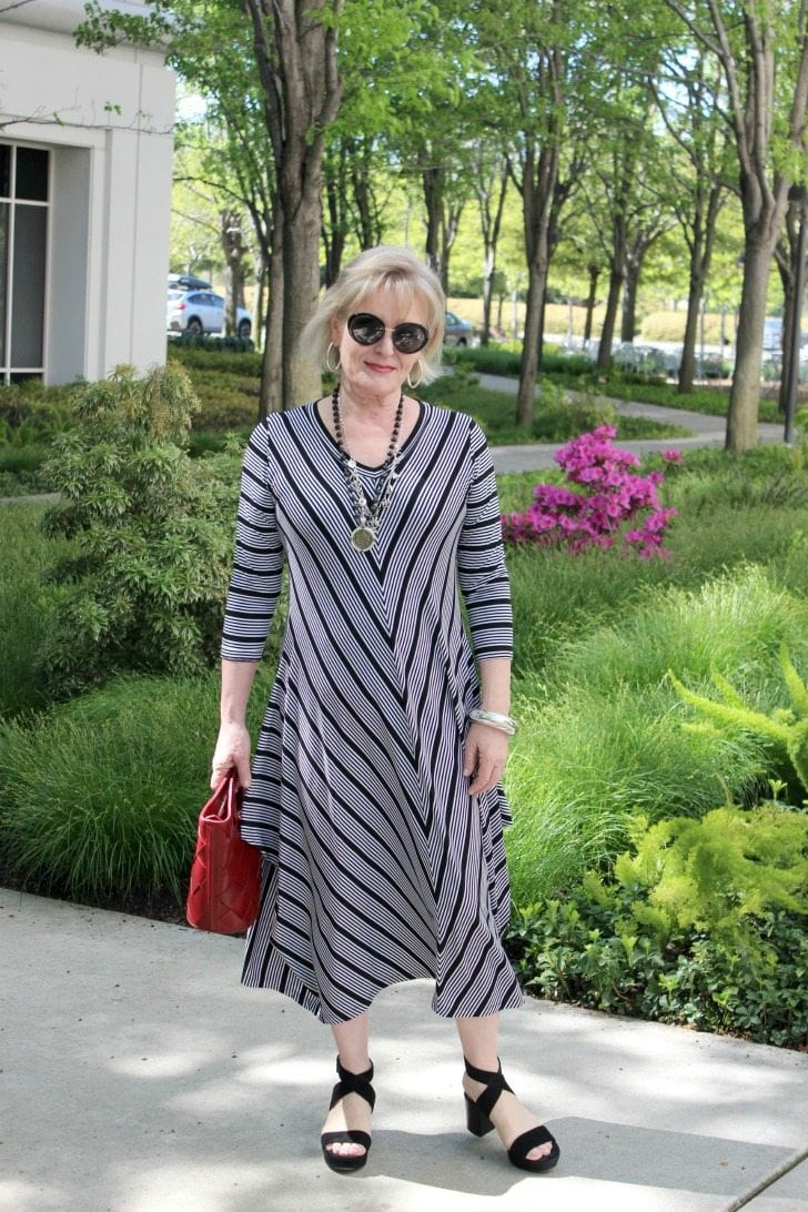 Jennifer Connolly of A Well Styled Life modeling Victoria dress from Artful Home