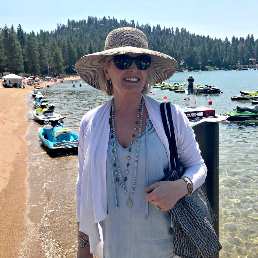 Fashion blogger Jennifer Connolly wearing Eric Javits hat at Lake Tahoe