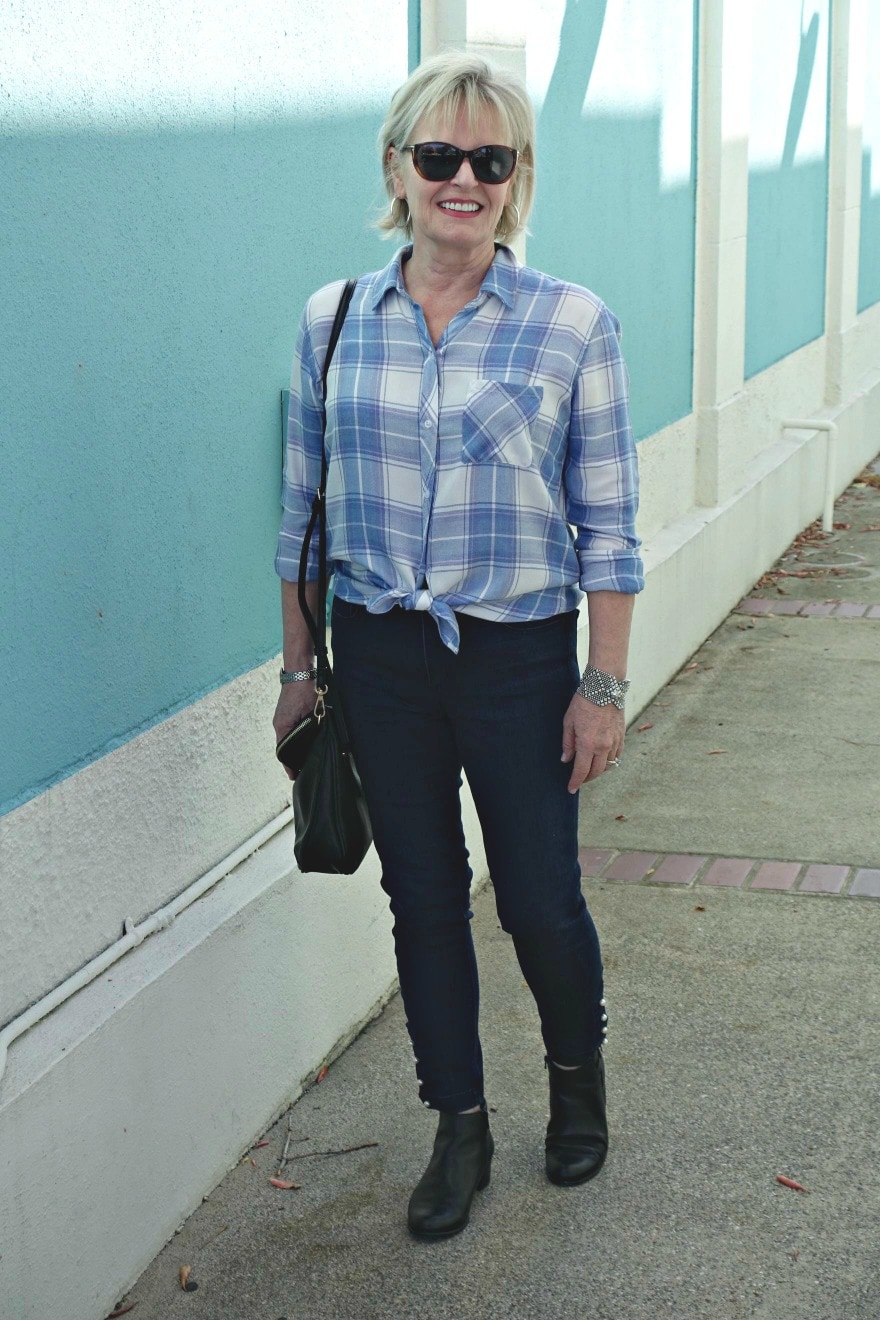 Jennifer Connolly of A Well Styled Life wearing casual outfit of skinny jeans and plaid flannel shirt