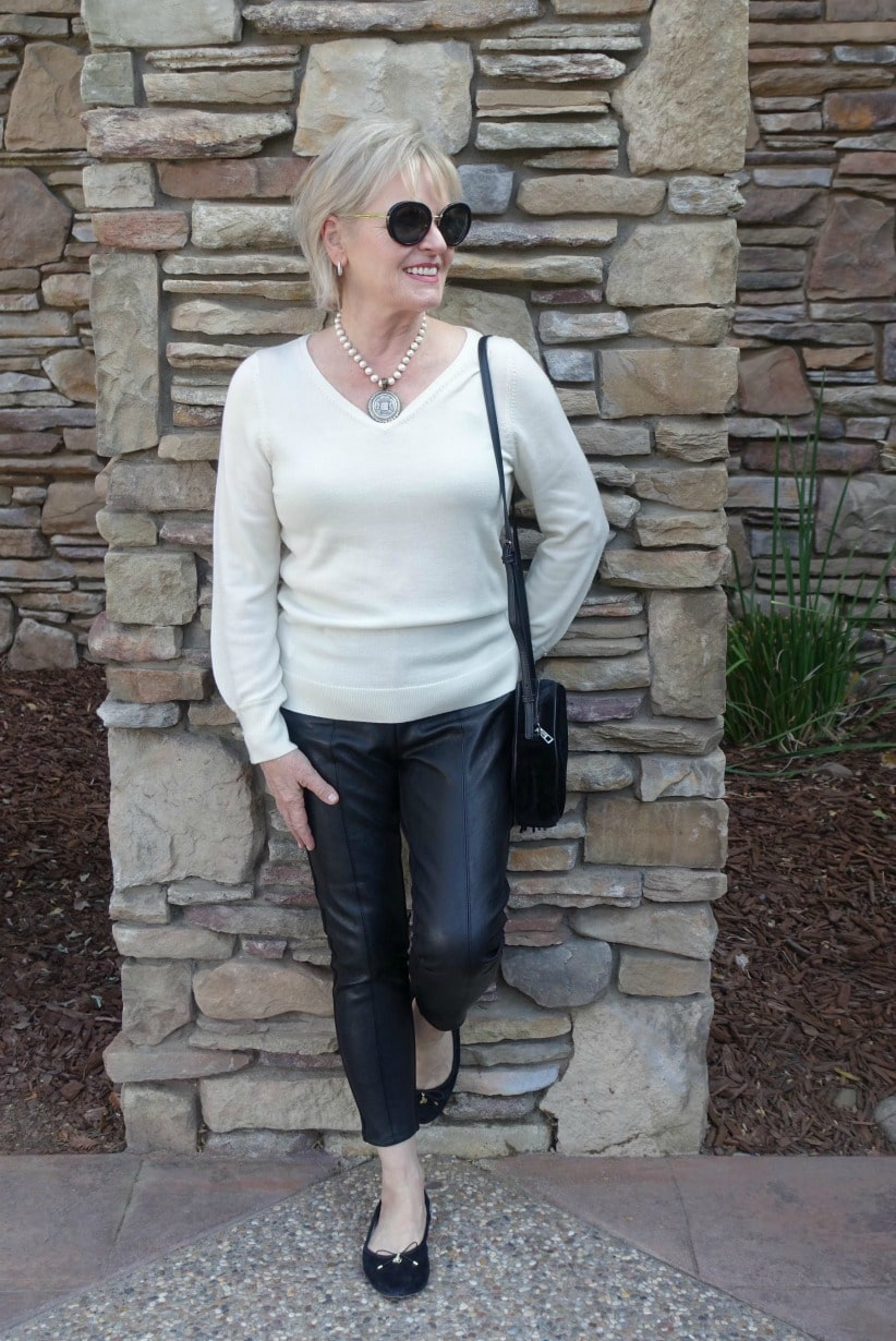 Jennifer Connolly of A Well Styled Life showing how to wearing leather leggings over 50