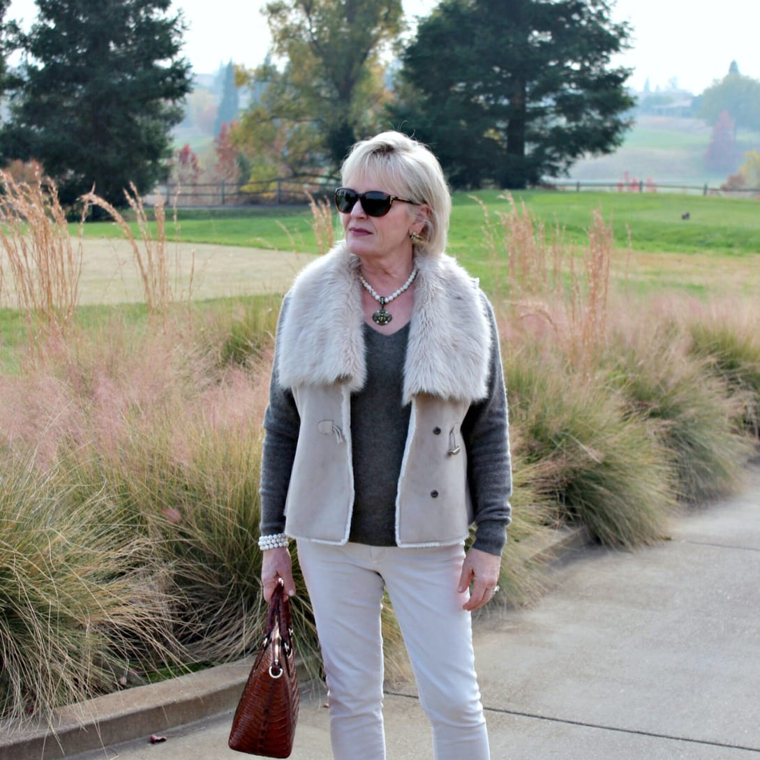 style blogger jennifer connolly wearing beige faux fur with neutral accessories