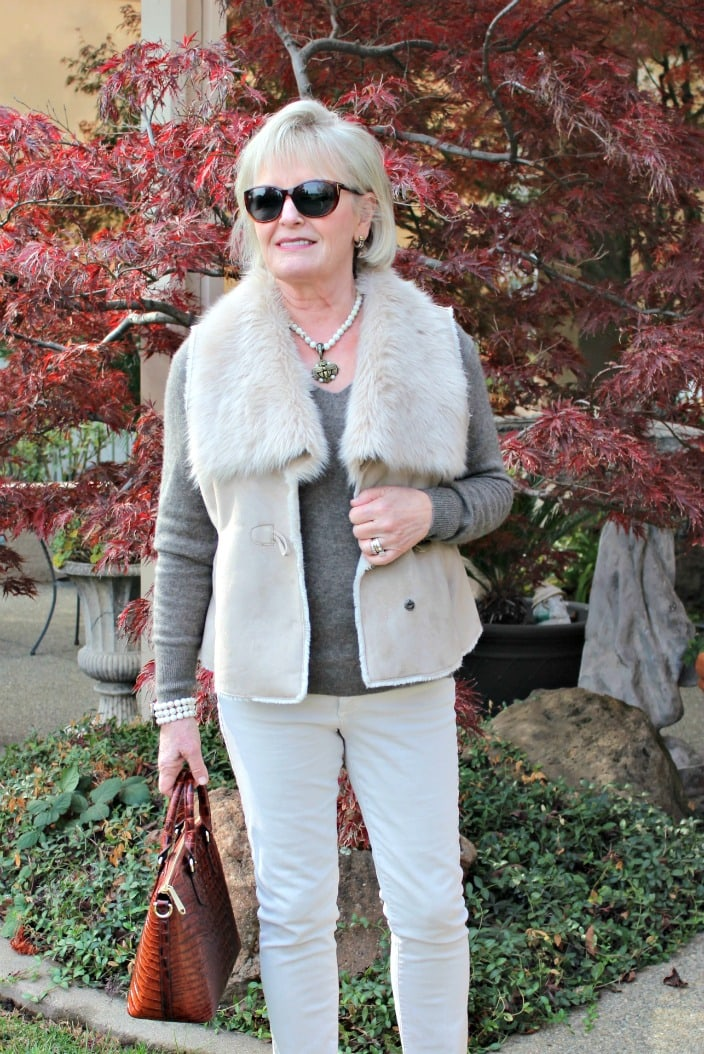 jennifer connolly wearing column of beige with faux fur vest
