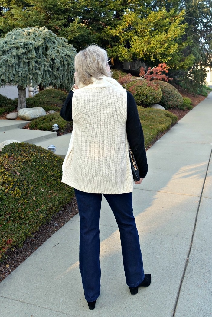 the ribbed knit back of sherpa vest and boot cut jeans on A Well Styled Life
