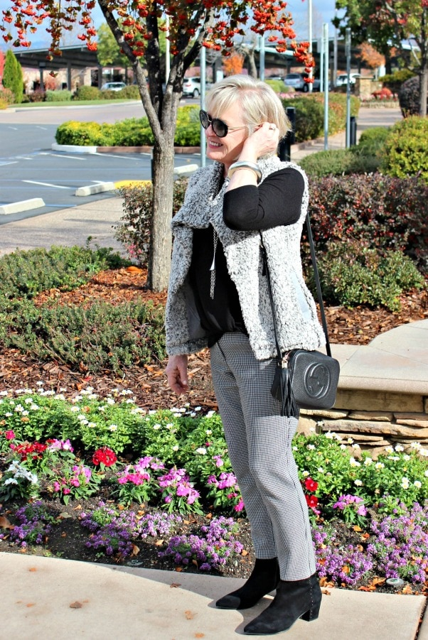 jennifer connolly of a well styled life wearing black gingham pants and gray fuzzy vest