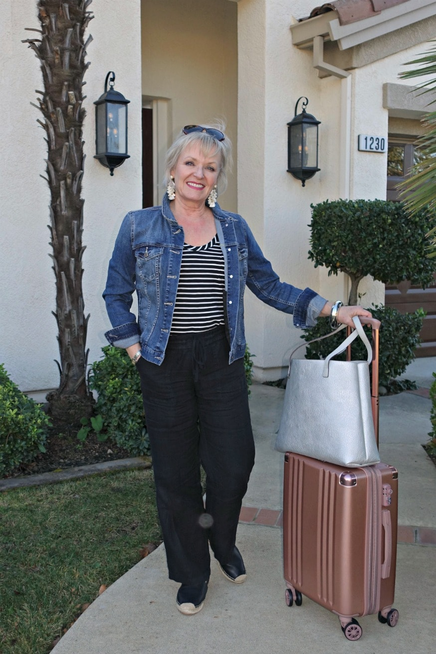 """Jennifer Connolly of A Well Styled Life using Calpak 20"""" spinner"""