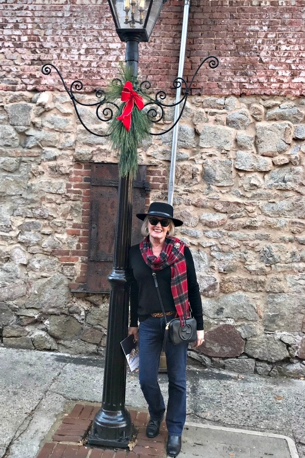 Jennifer Connolly of A well Styled life in black fedora, plaid scarf and jeans