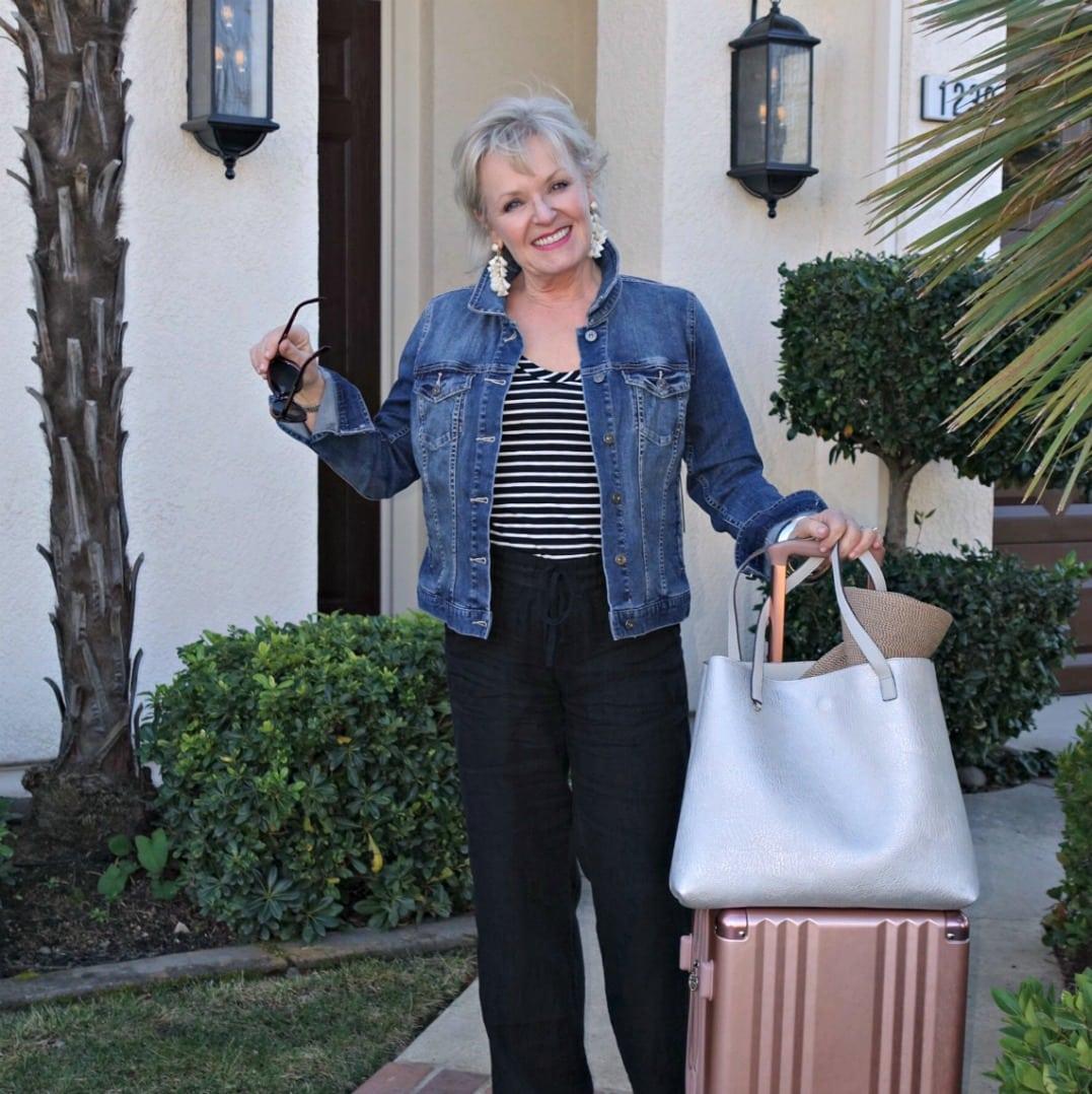 "Jennifer Connolly traveling with Calpak 20""spinner bag from Nordstrom"