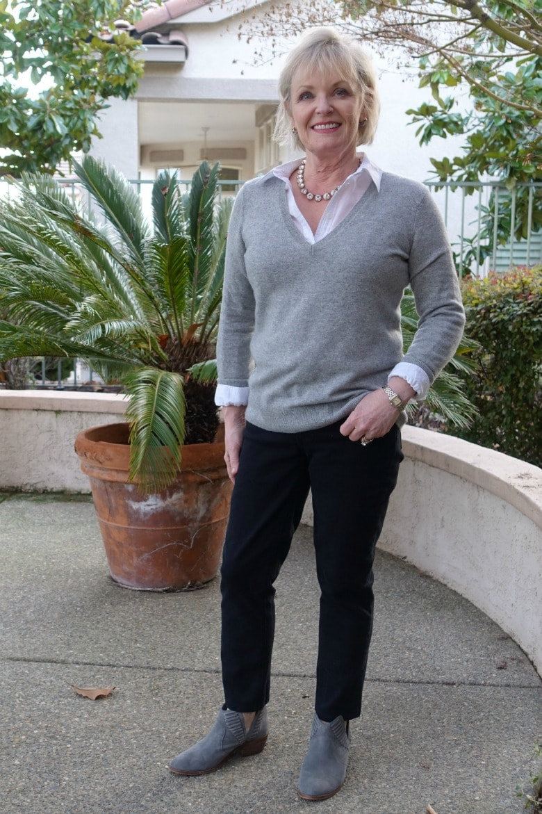 Jennifer Connolly of A Well Styled Life showing 5 ways to style v-neck sweater and black jeans