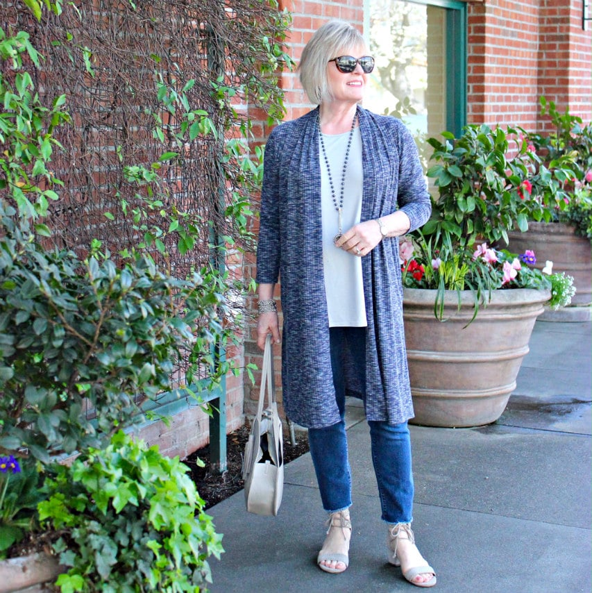 Jennifer Connolly of A Well Styled Life showing why a long sweater makes you look taller and slimmer
