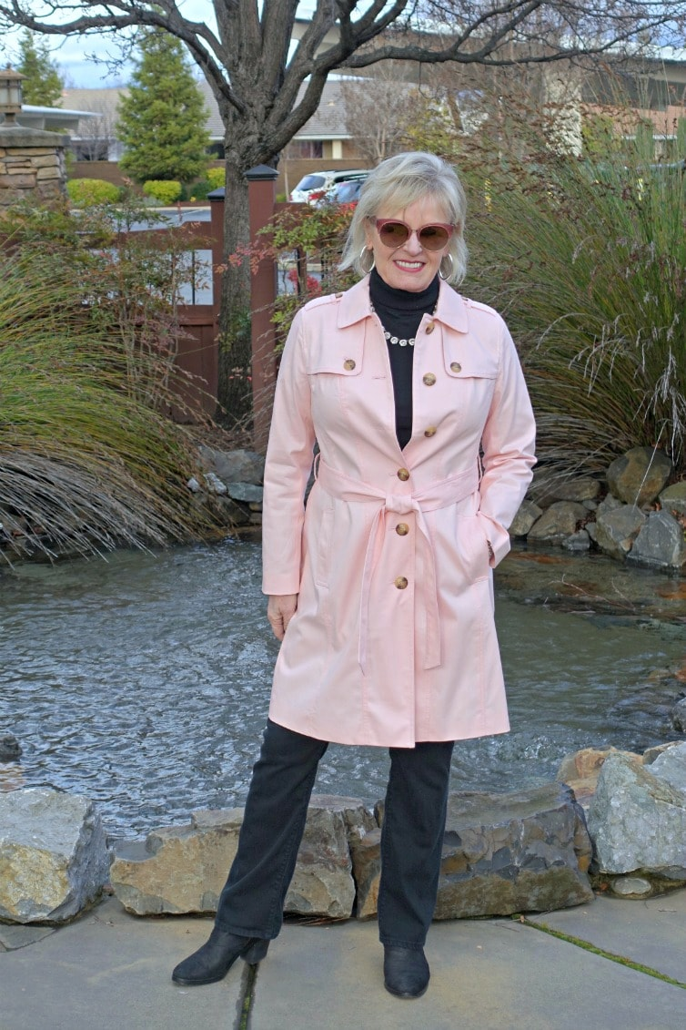 Jennifer Connolly of A Well Styled Life wearing a column of black underTalbots Modern Trench coat in pink
