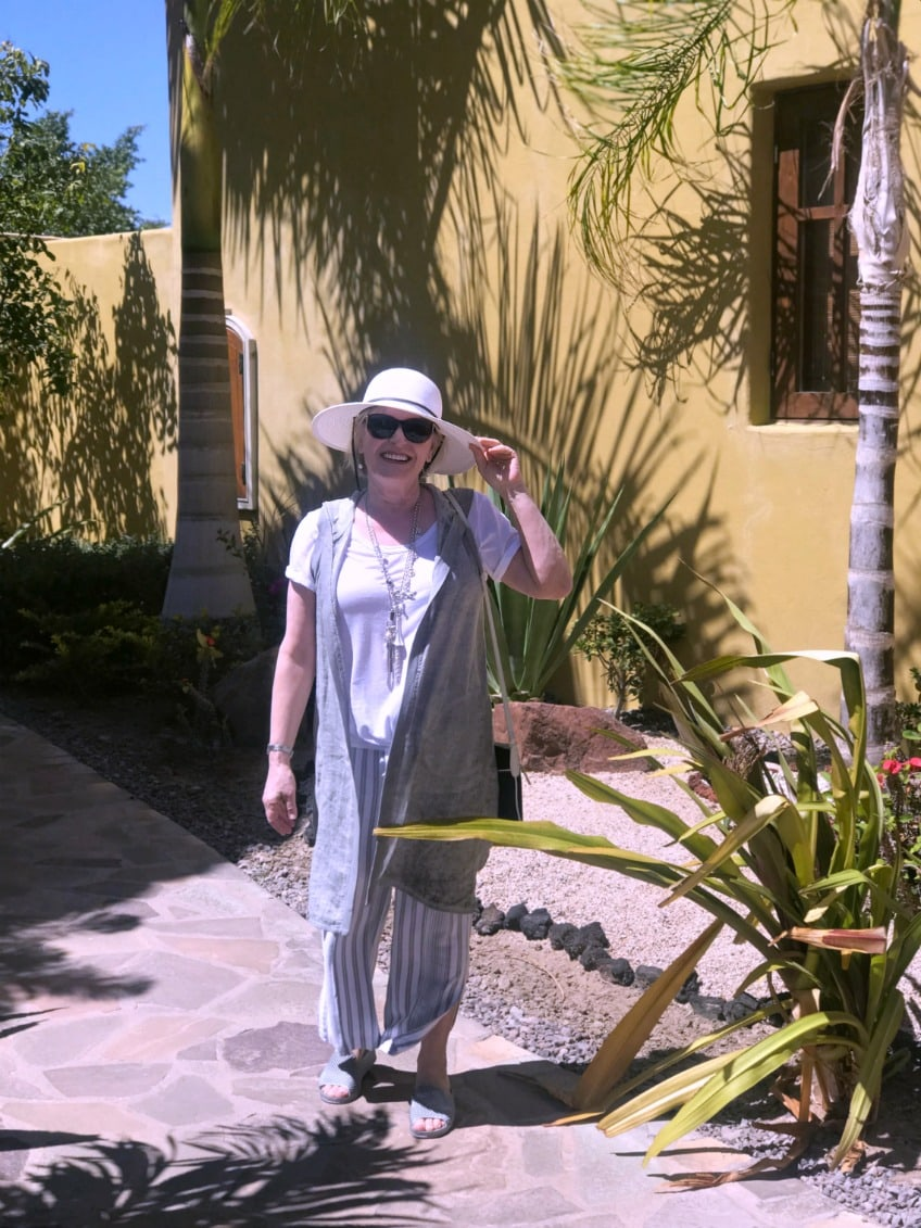 Jennifer Connolly of A Well Styled Life wearing Columbia faux straw hat, line vest and linen pants