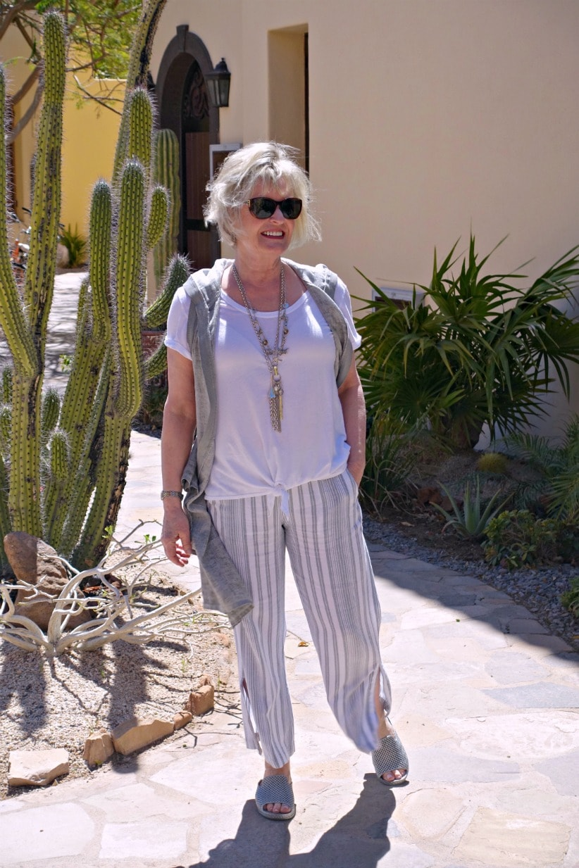 Jennifer of A Well Styled Life wearing linen duster over linen pants and white tee