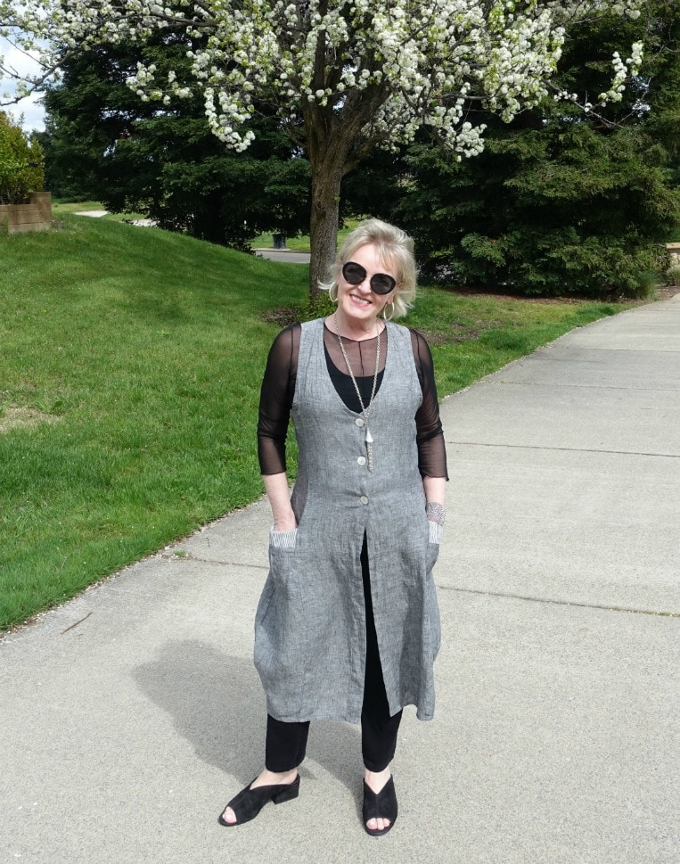 Hanover linen vest over white shirt and gray jeans on Jennifer of A Well Styled Life