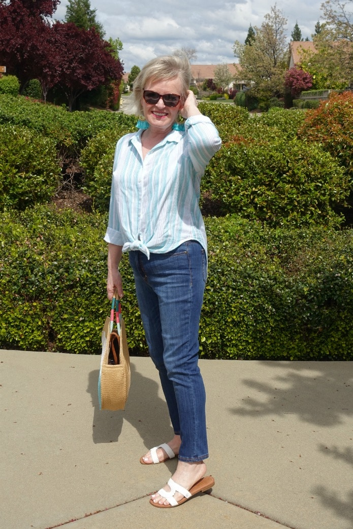 Jennifer Connolly of A Well Styled Life wearing striped shirt and blue jeans from Walmart