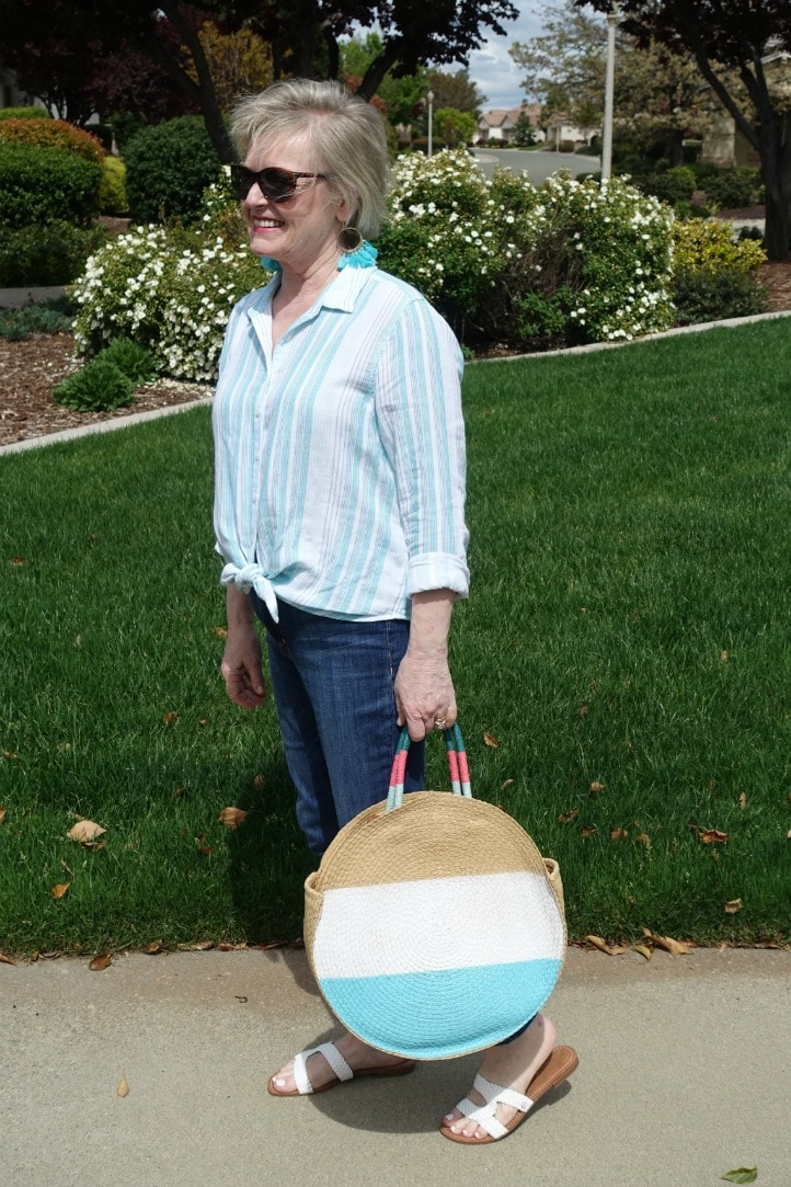 striped shirt and straw tote styled with blue jeans on Jennifer Connolly of A