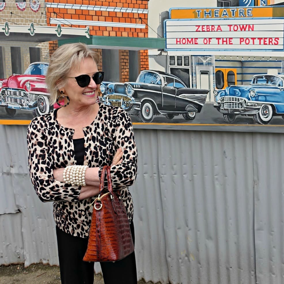 Jennifer Connolly of A Well Styled Life wearing leopard cardigan with dark sunglasses