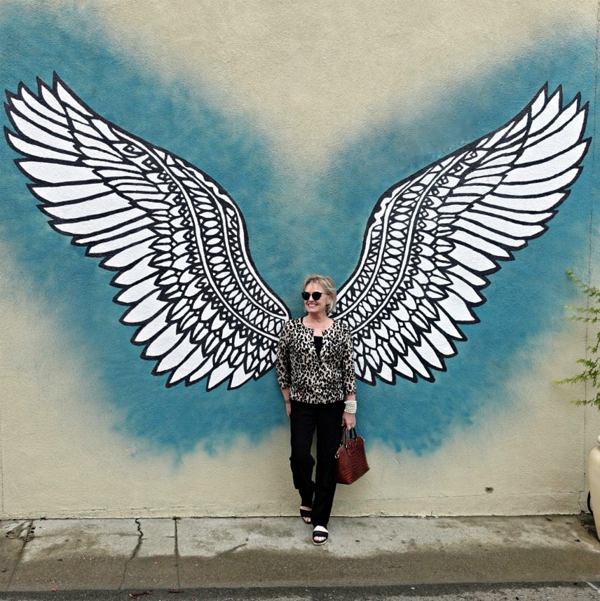 Jennifer Connolly standing in front of a wing mural