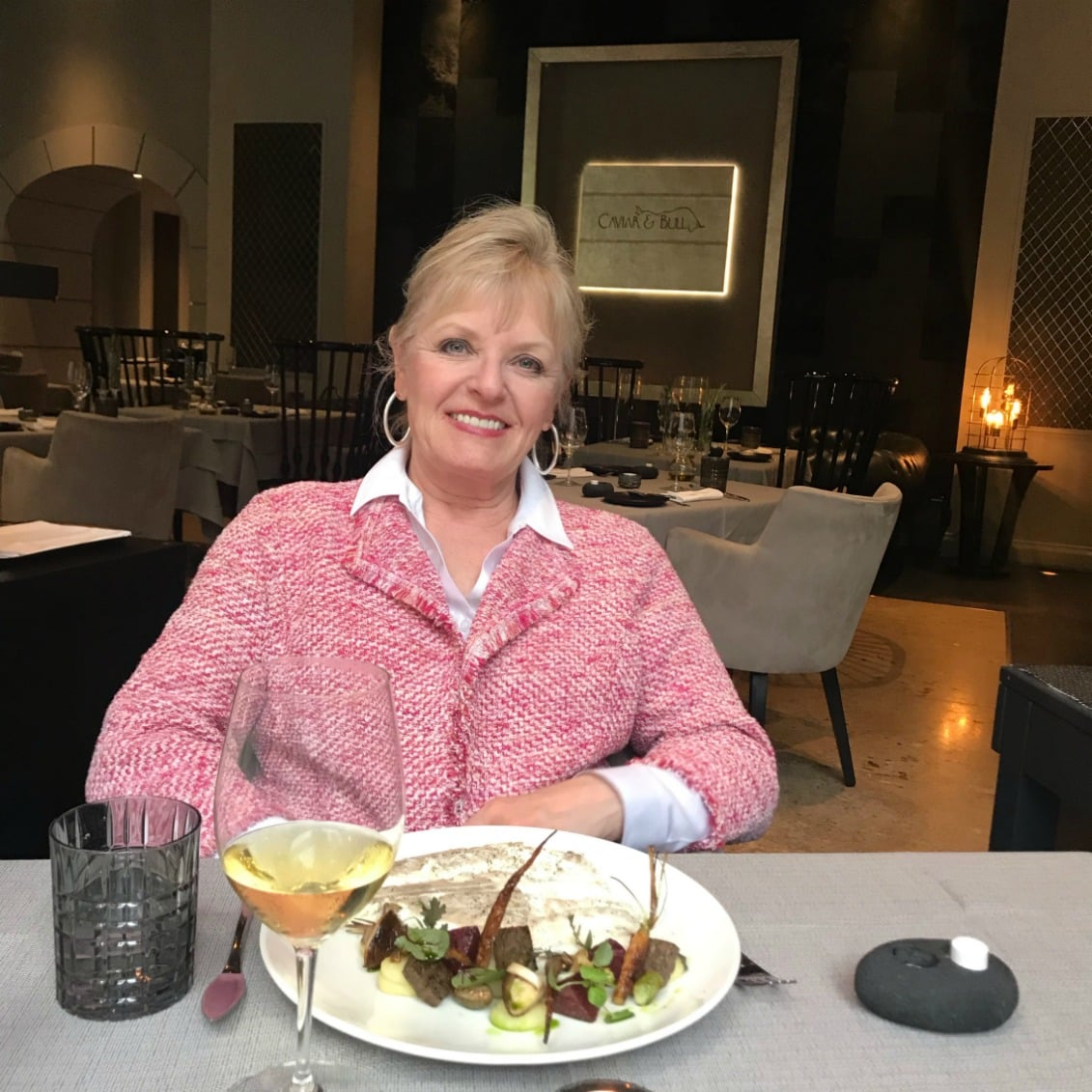 Jennifer Conneatting at the Caviar and Bull restaurant in Budapestolly of A Well Styled Life