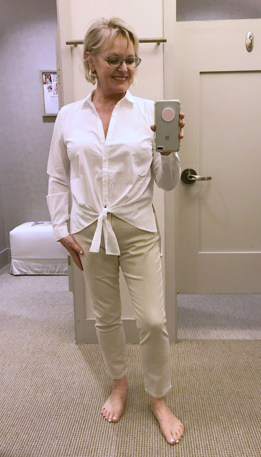 stretch white shirt and beige slim jeans on over 50 style blogger Jennifer of A Well Styled Life