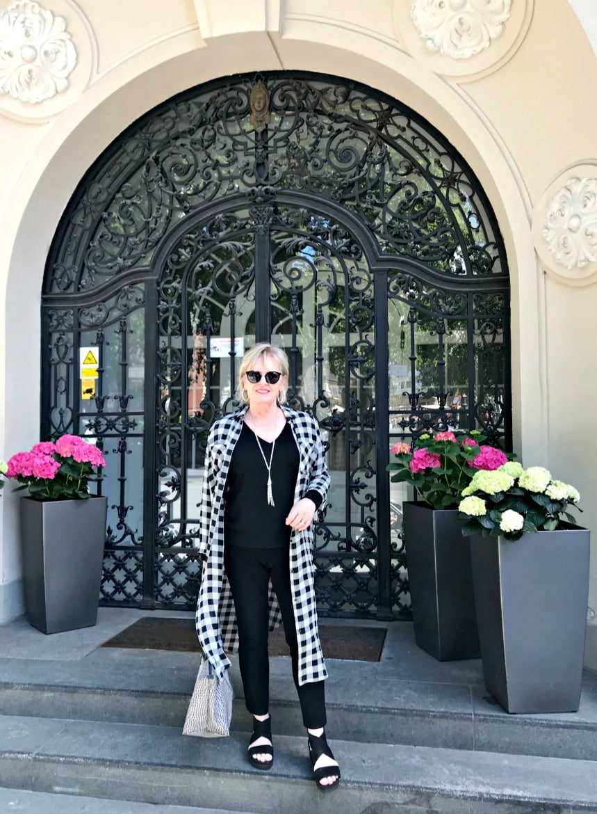 Jennifer Connolly of A Well Styled life showing how to stretch a travel wardrobe