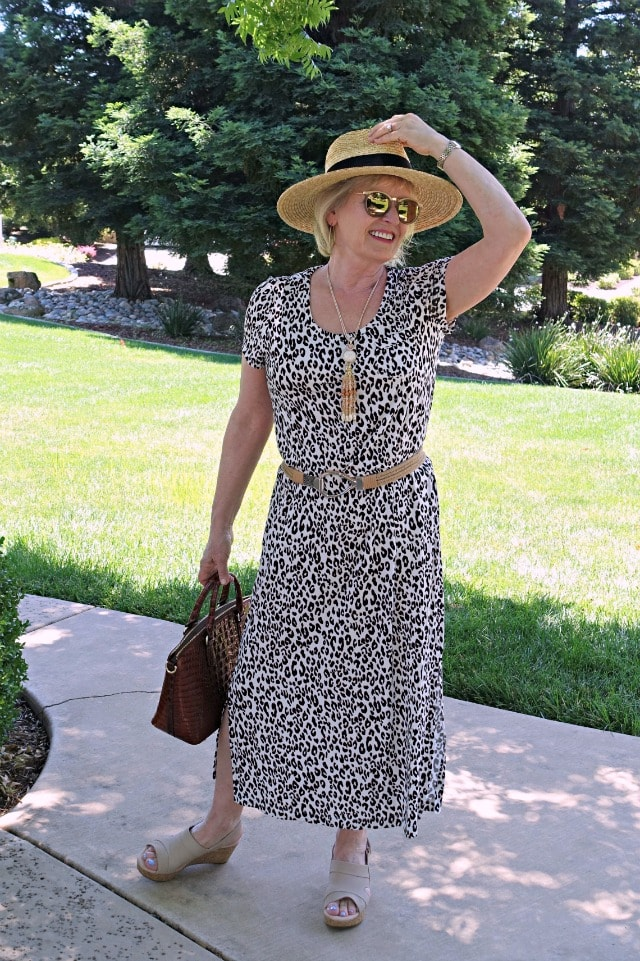 Jennifer Connolly of A Well Styled Life styling a leopard sleep shirt as a dress with straw hat, stretch belt and wedge sandals
