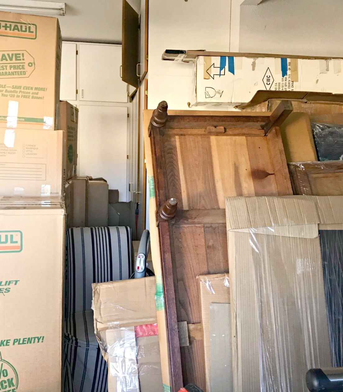 boxes and antique armoire pieces in garage