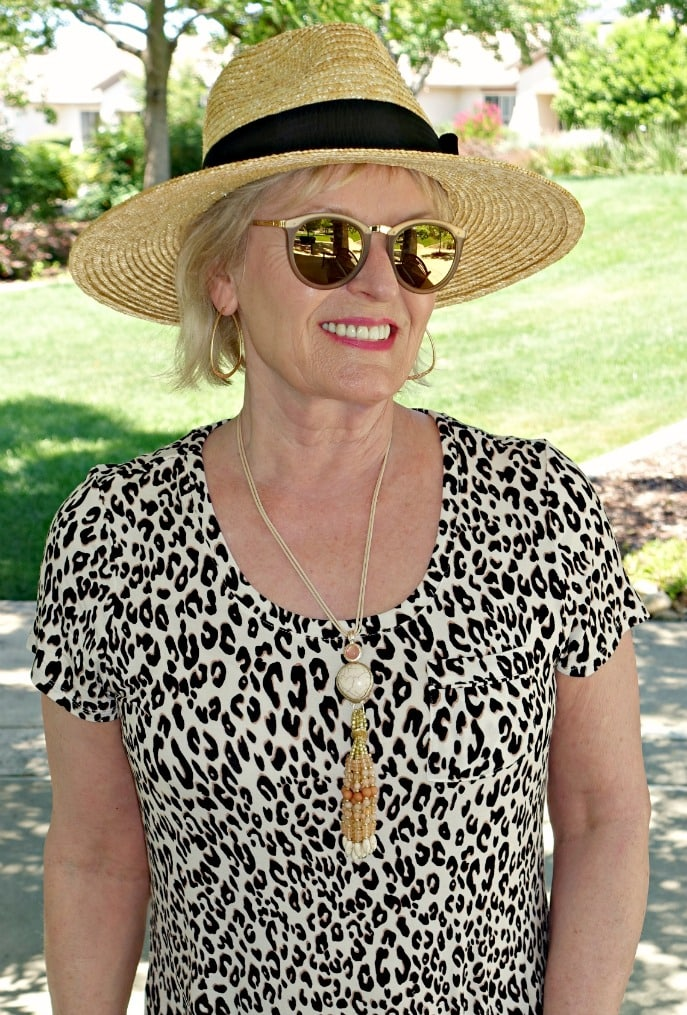 Jennifer Connolly of A Well Styled Life wearing straw hat from Nordstrom and leopard from Soma