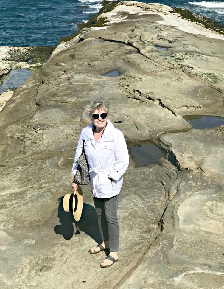 Jennifer Connolly of A Well Styled Life in white windbreaker on Malaspina Galleries