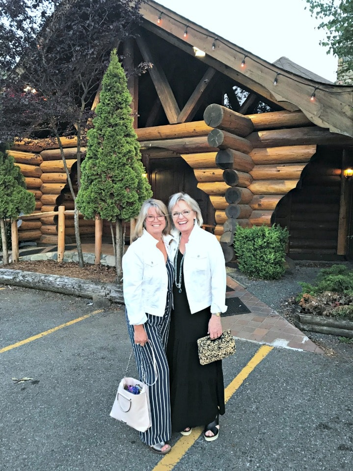 Jennifer Connolly and her sister-in-law wearing white denim jackets over jumpsuit and maxi dress