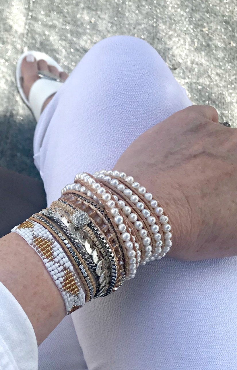 Jennifer Connolly of A Well Styled Life wearing white Victoria Emerson bracelets with white Eileen Fisher crepe pants