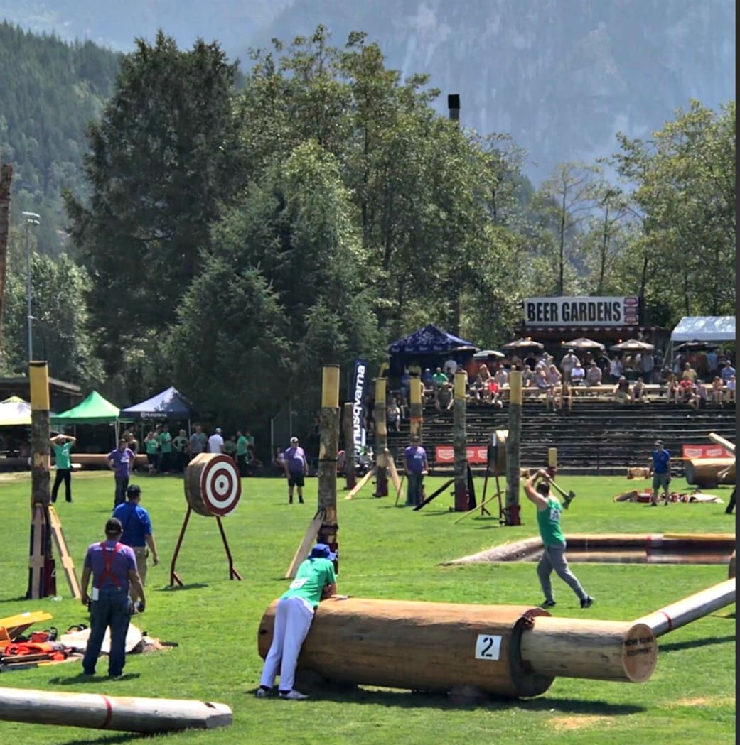 man throwing and axe in competition in Squamish BC