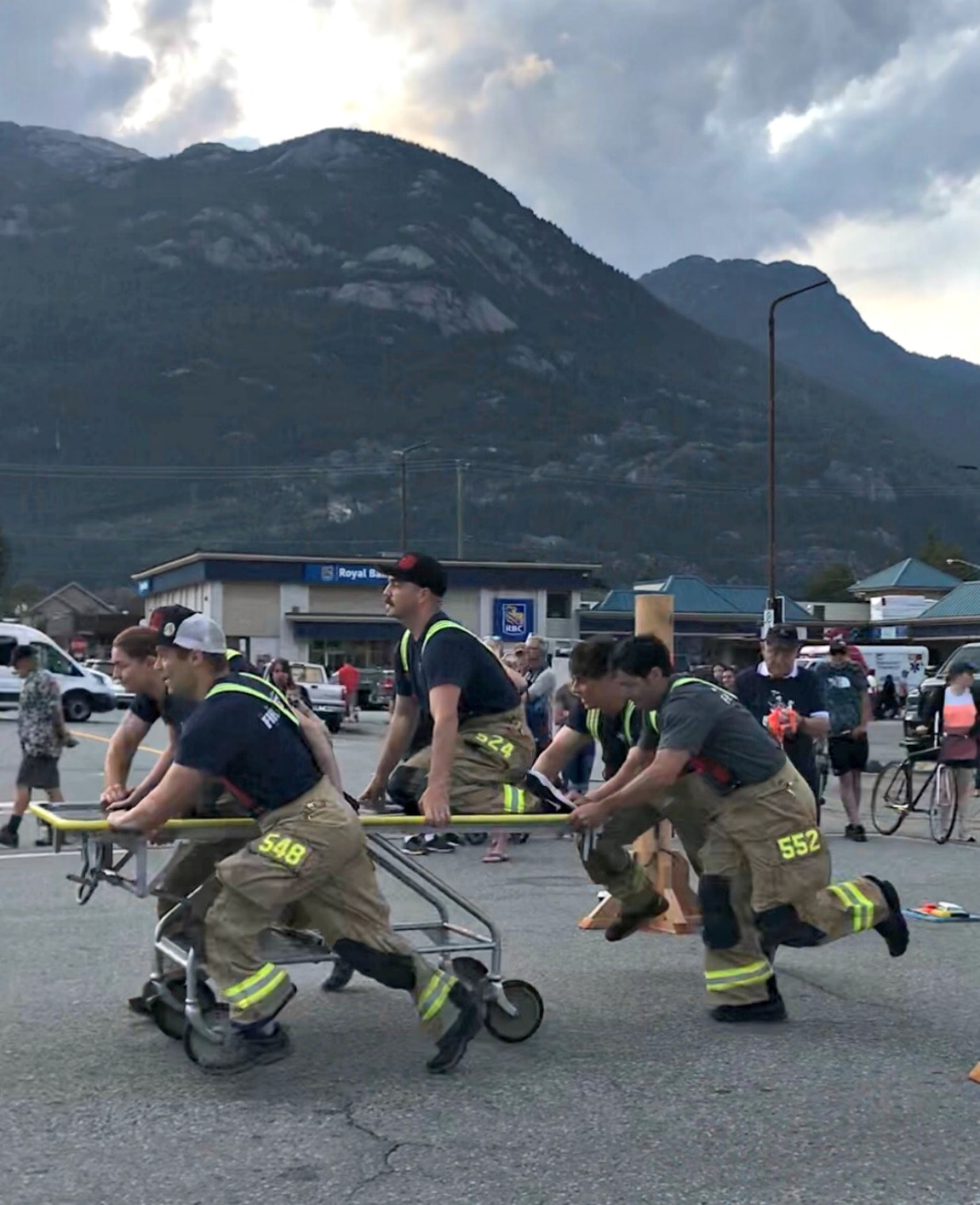 5 firefighters pushing a gurney in a bed race in Squamish BC