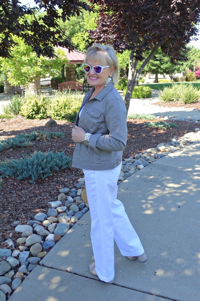 Jennifer Connolly of A Well Styled Life wearing casual look of white trouser jeans ans gray denim jacket from Talbots