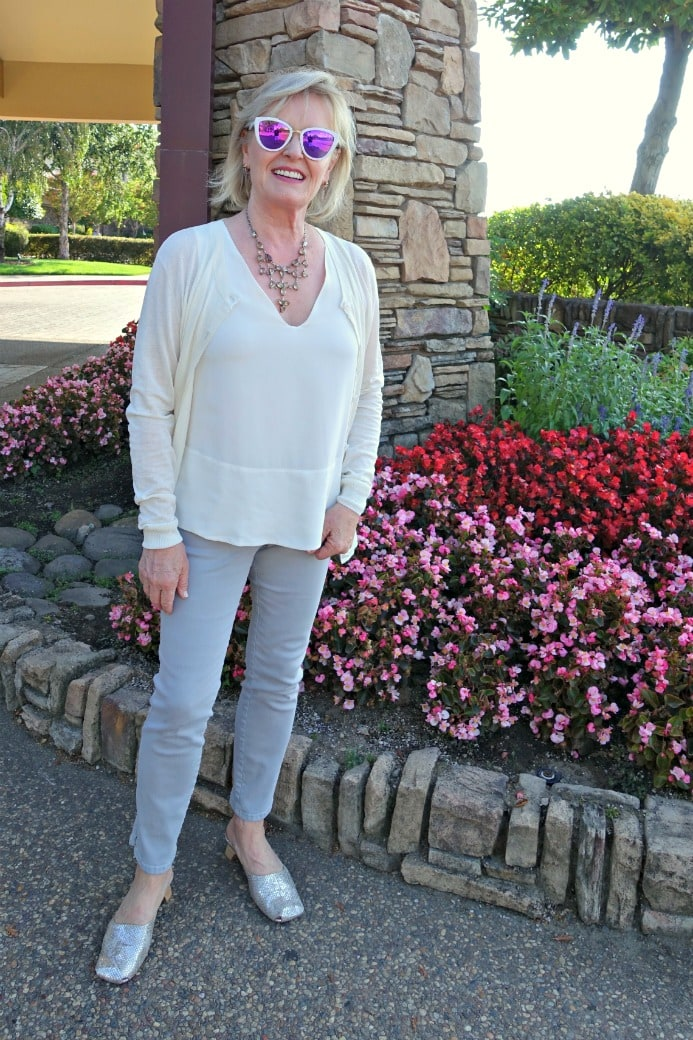Jennifer Connolly of A Well Styled Life wearing casual outfit with cream and gray