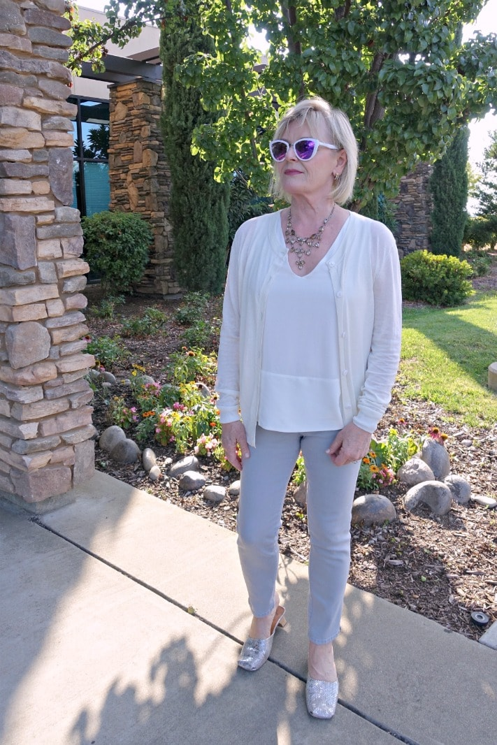 Jennifer Connolly of A Well Styled Life wearing ivory silk top and cardifan from LilySily with NJDJ gray jeans