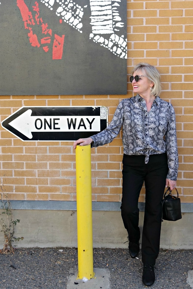 Jennifer Connolly of A Well Styled Life styling black and white snake print blouse and black jeans from Walmart