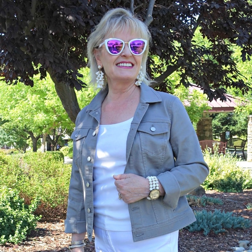 Jennifer Connolly of A Well Styled Life wearing classic denim jacket in stone color from Talbots and white tassel earrings